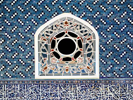 Stained window on ceramic tiled wall photo