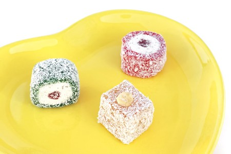 Turkish delight in a decorative yellow plate photo