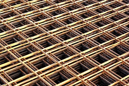 Stacked rebar grids at the construction site photo