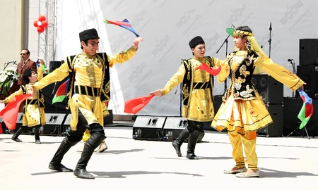 Istanbul - April 25, 2010: Azerbaijan group perform folk dance on Children's Day at Maltepe Stock Photo - 7076901