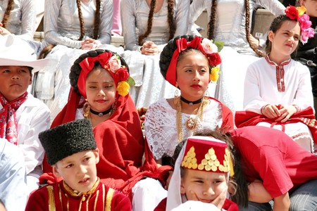 show folk: Istanbul - April 25, 2010: Children in traditional costumes during the performance on Childrens Day at Maltepe Editorial