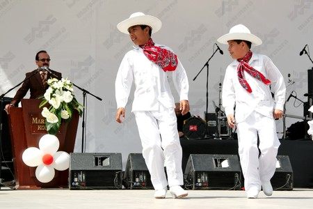 Istanbul - April 25, 2010: Mexican children in traditional costume on Children's Day at Maltepe Stock Photo - 7076913