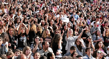 spectators: Istanbul - April 25, 2010: Fans of Manga rock group who perform live at Maltepe Campus