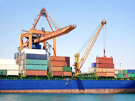 Stack of freight containers on ship deck Stock Photo