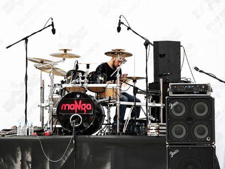ISTANBUL - APRIL 25: Drum player of the Manga group performs live on the stage at Marmara Egitim Koyu, Maltepe. April 25, 2010 in Istanbul, Turkey.
