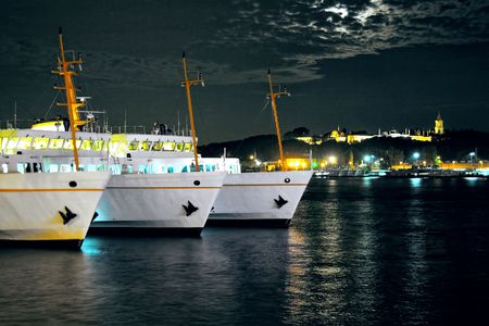 Night time at Karakoy with berthed passenger ships in Istanbul photo