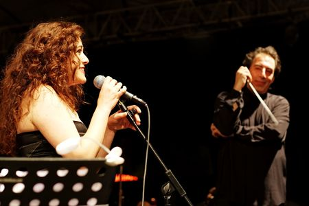 selva: ISTANBUL - JULY 11: Members of the Maltepe Symphonic Orchestra perform live at Maltepe open air stage. Soprano Selva Erdener with conductor Naci Ozguc