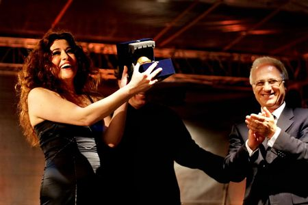 selva: ISTANBUL - JULY 11: Members of the Maltepe Symphonic Orchestra perform live at Maltepe open air stage. Soprano Selva Erdener with mayor Mustafa Zengin on the ceremony. Editorial