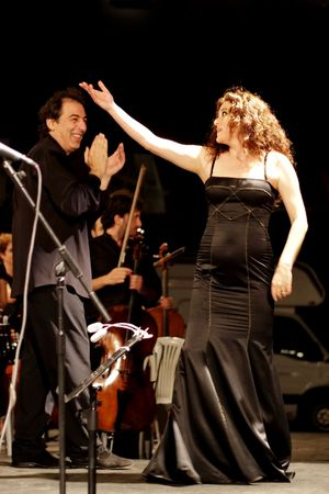 ISTANBUL - JULY 11: Members of the Maltepe Symphonic Orchestra perform live at Maltepe open air stage. Soprano Selva Erdener with conductor Naci Ozguc Stock Photo - 7405536