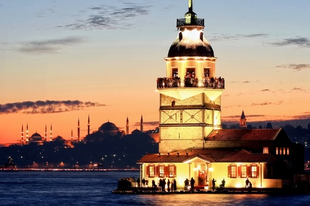 Istanbul Maiden Tower from the east in sunset. In the distance are such landmarks as Blue Mosque, Hagia Sophia and Topkapi Palace