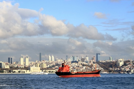 bosporus: Red cargo ship on Bosporus, Istanbul Stock Photo