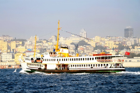 Istanbul city ferry boat in fall photo