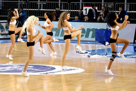 ISTANBUL - JANUARY 20: Efes Pilsen Cheerleaders perform routines at THY Euroleage Top 16 Championship basketball game Efes Pilsen vs Montepaschi Siena January 20, 2011 in Istanbul Stock Photo - 8652859