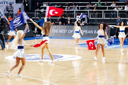 ISTANBUL - JANUARY 20: Efes Pilsen Cheerleaders perform routines at THY Euroleage Top 16 Championship basketball game Efes Pilsen vs Montepaschi Siena January 20, 2011 in Istanbul Stock Photo - 8652867
