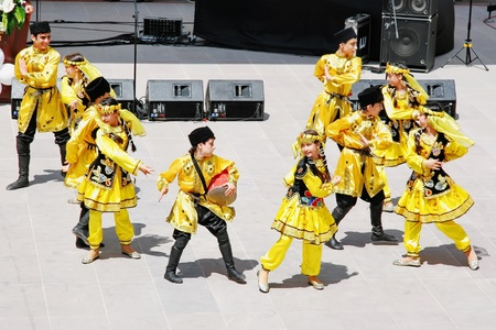 ISTANBUL - APRIL 23: Azerbaijan group perform folk dance in