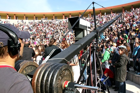 ISTANBUL - APRIL 23: Professional cameraman records live  at National Sovereignty and Children Day festival on April 23, 2010 in Istanbul, Turkey