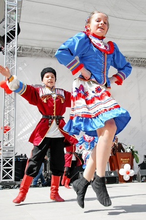 ISTANBUL - APRIL 23: Ukrainian couple in traditional costume perform folk dance at