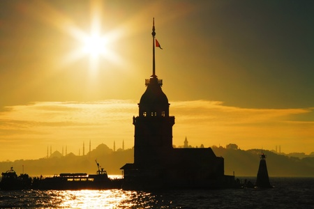 Istanbul Maiden Tower against sun in summer time 스톡 사진