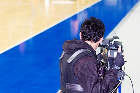 ISTANBUL - JANUARY 20: Professional cameraman records live while THY Euroleage Top 16 Basketball Championship, Efes Pilsen vs Montepaschi Siena January 20, 2011 in Istanbul
