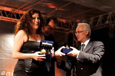 selva: ISTANBUL - JULY 11: Members of the Maltepe Symphonic Orchestra perform live at Maltepe open air stage on July 11, 2010 in Istanbul.  Soprano Selva Erdener with mayor Mustafa Zengin on the ceremony. Editorial