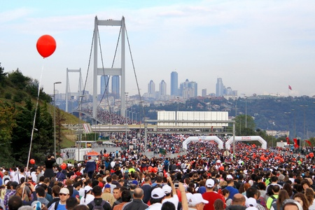 intercontinental: ISTANBUL - OCTOBER 17: Thousands of people in 32nd Intercontinental Eurasia Marathon run make their way through Bosporus suspended bridge on October 17, 2010 in Istanbul, Turkey.