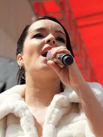 ISTANBUL - APRIL 23: Pop star Bengu Erden performs live on stage at Marmara Egitim Kurumlari on April 23, 2011 in Istanbul, Turkey.