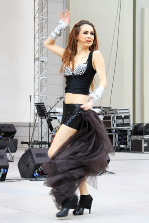 ISTANBUL - APRIL 23: An unidentified belly dancer performs during Bengu Erden Concert at Marmara Egitim Kurumlari on April 23, 2011 in Istanbul, Turkey.