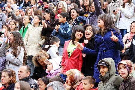 ISTANBUL - APRIL 23: Unidentified music fans cheer up during pop singer Bengu Erden performs live at Marmara Egitim Kurumlari on April 23, 2011 in Istanbul, Turkey.  Stock Photo - 9420079