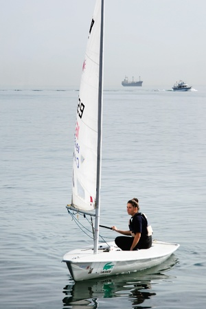 optimist: Istanbul, Turkey - November 2, 2008 : Girls train on optimist class yachts at Marmara sea. Sailor maneuvering carefully