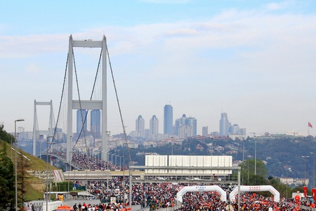 intercontinental: Istanbul, Turkey - October 17, 2010 : Thousands of people make their way through Bosporus suspended bridge during the 32nd Intercontinental Eurasia Marathon run.