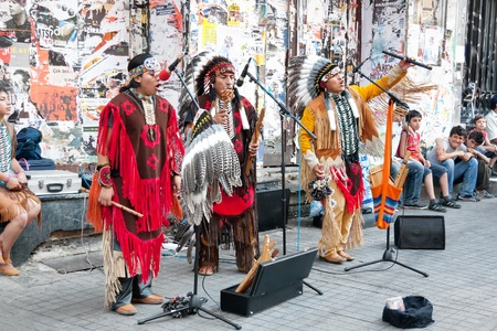 Unidentified Amerindians perform in traditional costumes during street show at Istiklal Street on July 06, 2010 in Istanbul. Beyoglu district is the major strolling street  in city.