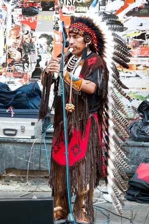 An unidentified Amerindian performs in traditional costume during street show at Istiklal Street on July 06, 2010 in Istanbul. Beyoglu district is the major strolling street  in city.