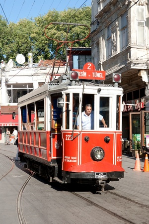 ISTANBUL - JULY 06: Unidentified driver drives nostalgic tram through Istiklal street, July 06, 2010 in Istanbul. Historic trams can not hold many passengers. The ride is relatively slow but pleasant
