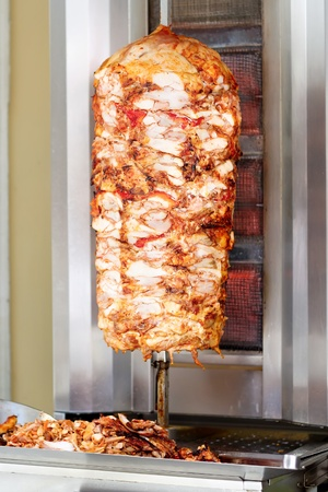 Kebab, meat roasted on large vertical spit photo