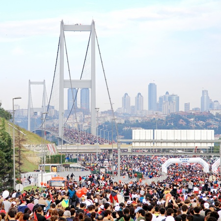 turkish man: ISTANBUL - OCTOBER 17: People run over streets during the 32nd Intercontinental Eurasia Marathon run on October 17, 2010 in Istanbul, Turkey.