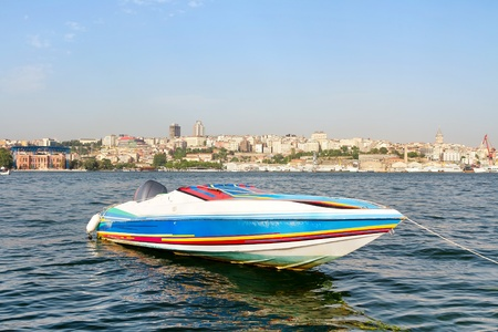 Colorful race boat in berth photo