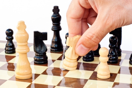 hand move: Chess game board Stock Photo