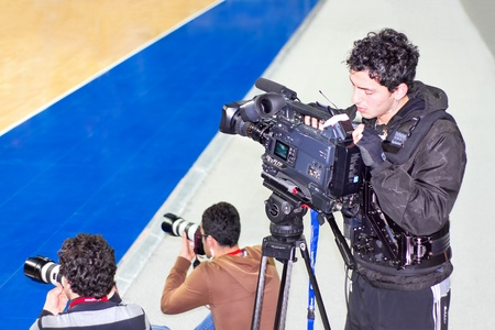 ISTANBUL - JANUARY 20: Unidentified cameramen record live during THY Euroleage Top 16 Basketball Championship, Efes Pilsen vs Montepaschi Siena January 20, 2011 in Istanbul Stock Photo - 10808211