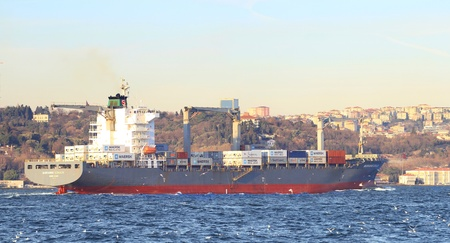marianne: ISTANBUL - DECEMBER 10: Container Ship, MARIANNE SCHULTE (IMO: 9215907, HK) sails with full of cargo in Bosporus on December 10, 2011 in Istanbul. 50,000 ships pass through the Straits every year. Editorial
