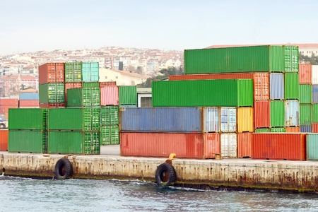 sea seaport: Containers stacked in quayside Stock Photo