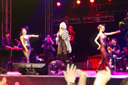 ISTANBUL - SEPTEMBER 18: Pop star Ajda Pekkan performs live during a concert at Maltepe on September 18, 2011 in Istanbul, Turkey. Concert stage on scene among excited spectators. Stock Photo - 12257370