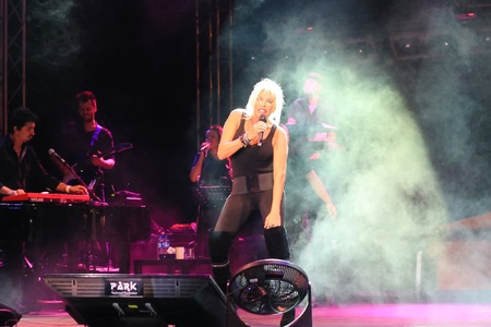 onstage: ISTANBUL - SEPTEMBER 18: Pop star Ajda Pekkan performs live during a concert at Maltepe on September 18, 2011 in Istanbul, Turkey.