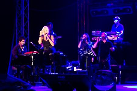 ISTANBUL - SEPTEMBER 18: Pop star Ajda Pekkan performs live during a concert at Maltepe on September 18, 2011 in Istanbul, Turkey.