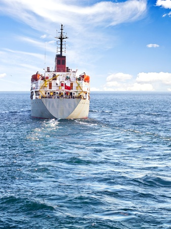 Cargo ship at open sea with a large copy space