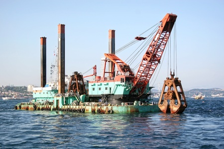 Floating dredging platform in the sea