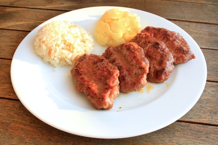Meatball plate with rice and mashed potatoes photo
