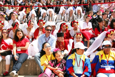 sovereignty: ISTANBUL - APRIL 23: International visitors wait their turn for dance during National Sovereignty and Children Day festival at Maltepe University on April 25, 2010 in Istanbul.