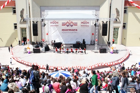ISTANBUL - APRIL 23: People watch as folk dance performance during 'National Sovereignty and Children Day' festival at Maltepe University on April 25, 2010 in Istanbul.