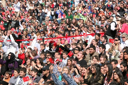 ISTANBUL - APRIL 23: Crowd of people watch as the dance performance during National Sovereignty and Children Day festival on April 23, 2010 in Istanbul.