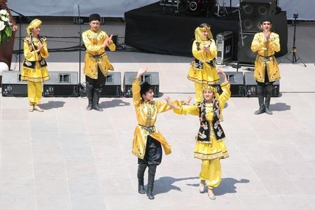 azerbaijan: ISTANBUL - APRIL 23: Azerbaijan group perform folk dance during National Sovereignty and Children Day festival at Maltepe University on April 23, 2010 in Istanbul.